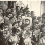 School children singing 1940s (Trujillos photo in background)
