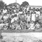 30  School teachers and children group photo