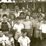 Luis Hess and Mr. Scheer with school children