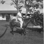 Unknown settler on horse - Sosua house in background