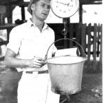 Eli Topf weighing milk